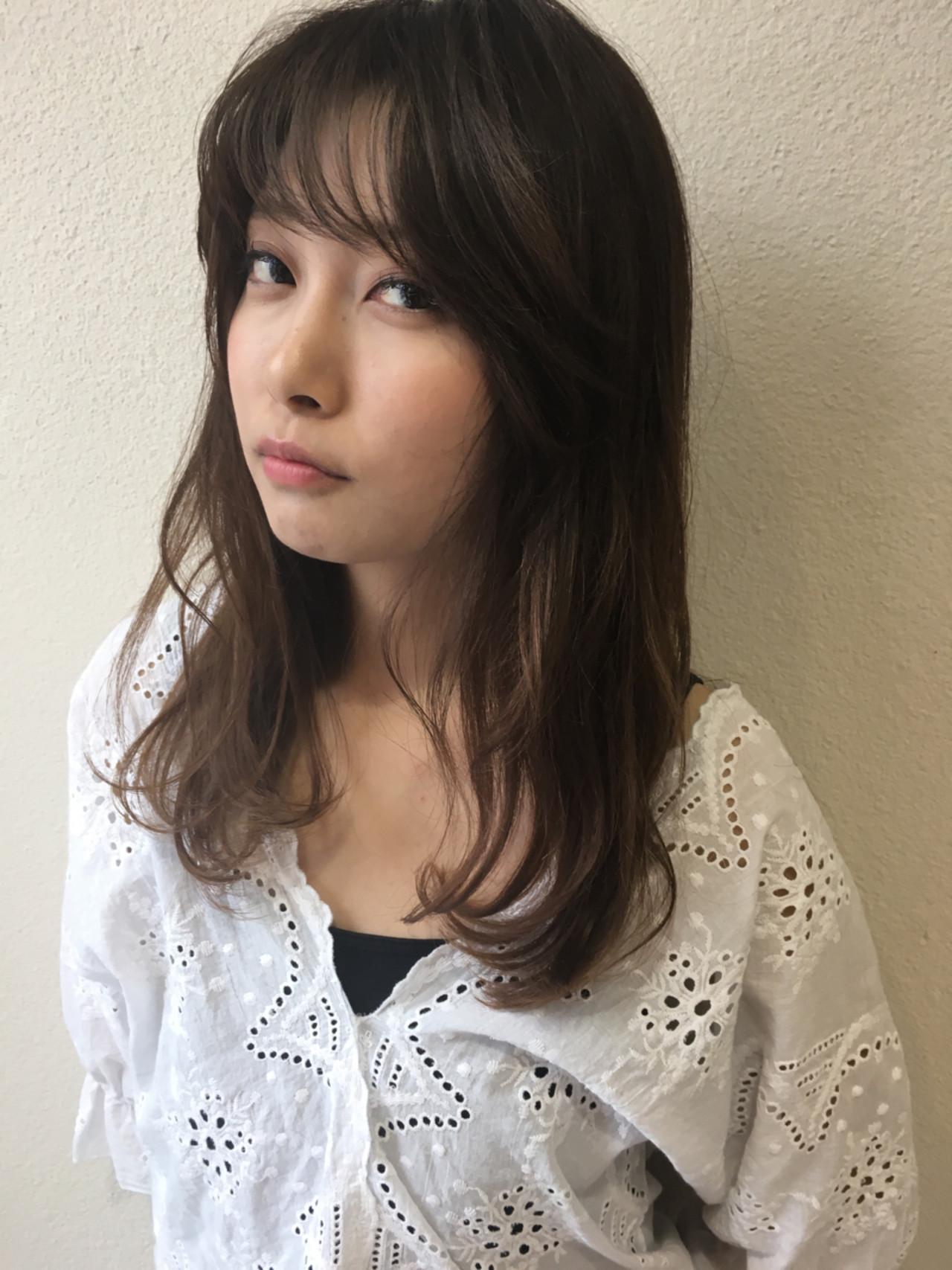 面長さんのデメリットを打ち消すフェミニンヘア 斉藤由香利