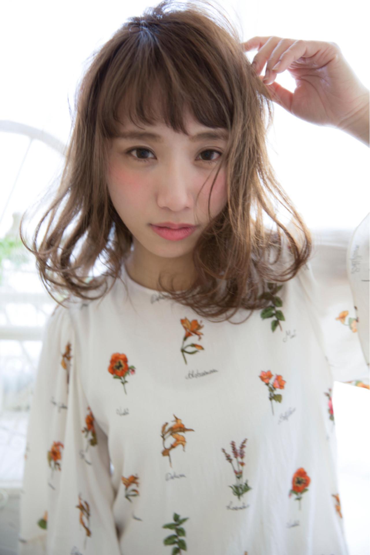 束感と揺れ感で女子力高めの癒し系スタイル mizuho