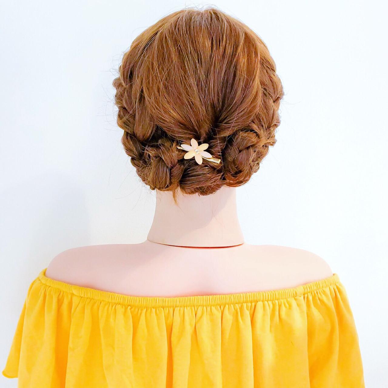 ロングヘアをきっちり編み込むスタイル 美容師 HIRO