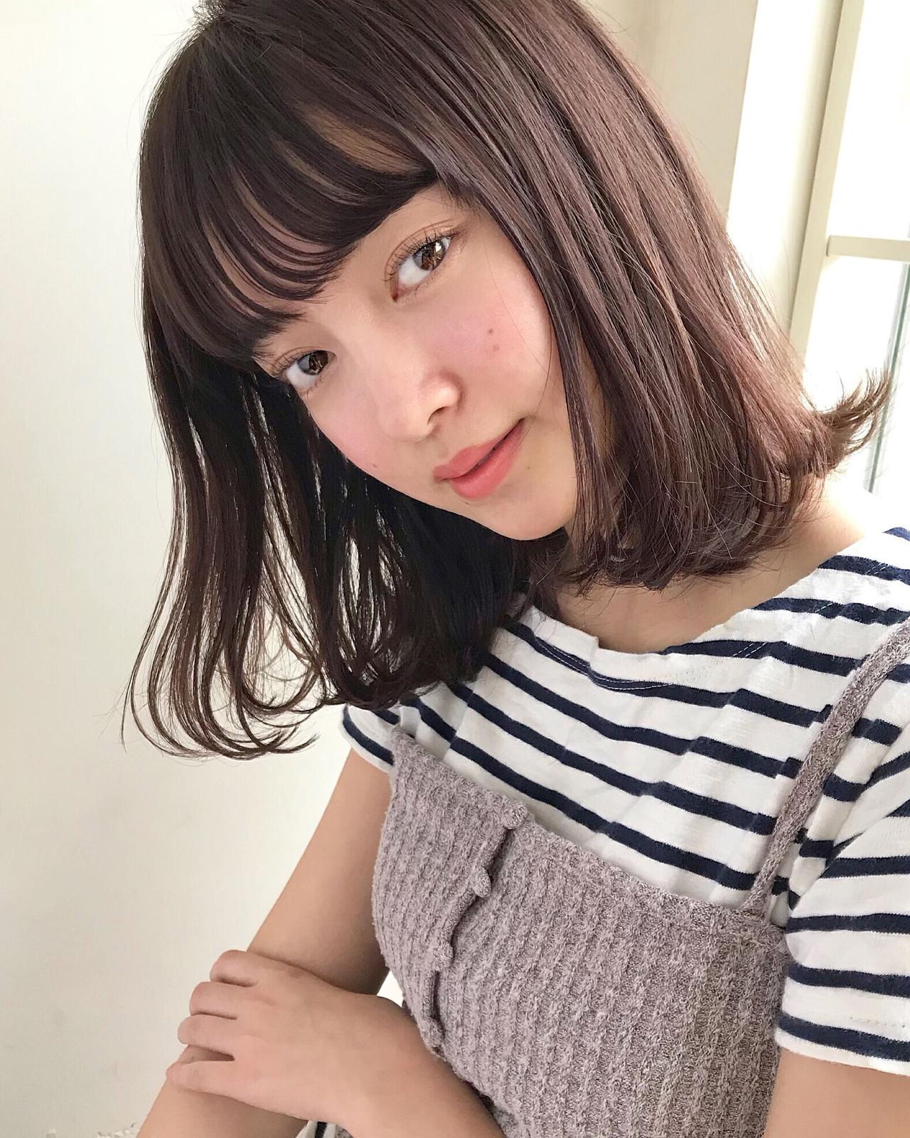小顔効果も期待できちゃうミディアムのダークブラウンカラー 伊藤愛子 GARDENGARDEN omotesando